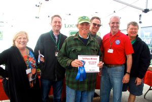 1st Place Best Tasting Strawberry winner Hank Delvin, Sr. with judges
