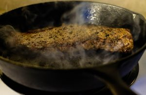 Red Hot cast Iron skillet seals juices and flavor for a tender steak