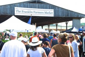 The Franklin community starts their Labor Day weekend shopping for local farm food.