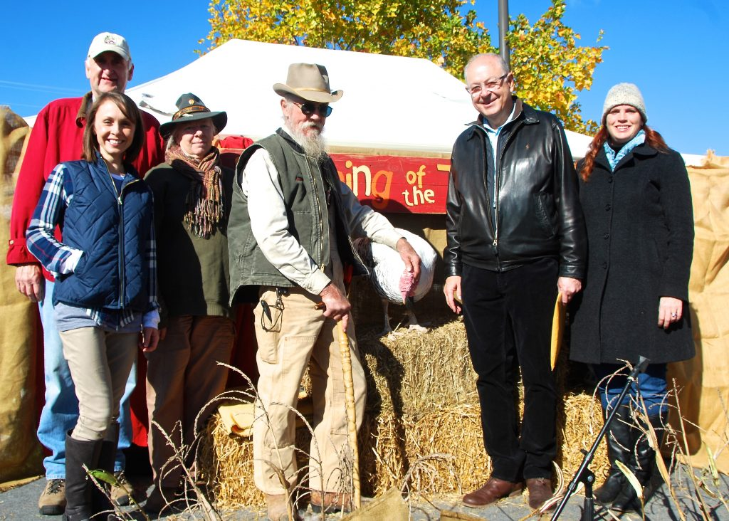 LTR Ed Harlan Assistant Agriculture Commissioner, Ashlea Hogancamp owner of Herban Market, Sue and Adam Turtle of Earth Advocates Research Farm, Danny the Turkey, Franklin Mayor Ken Moore and Market Executive Director Amy Tavalin